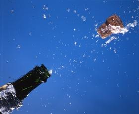 Champagnecorkpoppingflyingwaterliquiddro